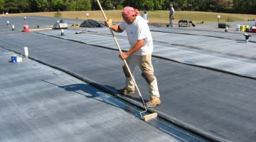 one of our roofing contractors on a flat roof