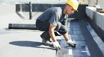 contractor doing flat roofing