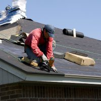 roofing contractor on a roof